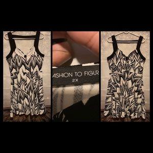 Black and white sleeveless dress.